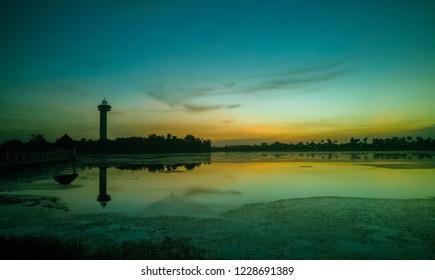 Sunset at Koh Klang nam public park in Sisaket Province, Thailand