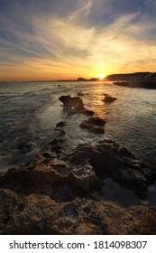 Sunset at La Cala de Cantalar in the province of Alicante, Spain.