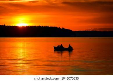 Sunset lake boat fishing scene. Fishermen boat sunset fishing. Sunset lake fishing - Shutterstock ID 1946070535