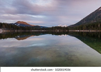 Sunset at lake Hintersee in the Alps of Bavaria on a cloudy day in winter