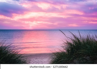 Sunset at Lake Michigan. Personal paradise on a beautiful white sand beach. Rosy Mound park, Ottawa County, Michigan, USA. Tranquil lakeshore background with copy space.