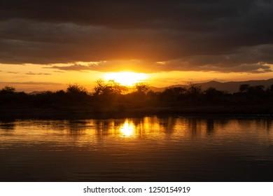 Sunset at a lake in Tsavo West National Park, Kenya