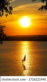 Sunset lake view windsurfing. Windsurfing sunset