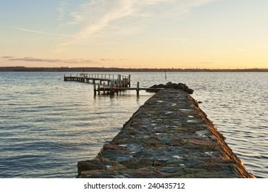 Sunset at a landing stage in the inlet at Horsens, Denmark