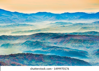 Sunset landscape in beautiful blue mountains and mist hills