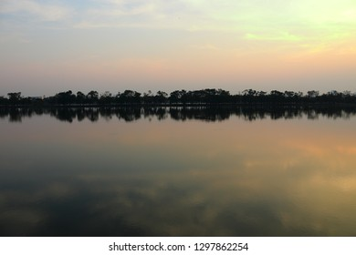 Sunset landscape with blue and reflection of lake water.