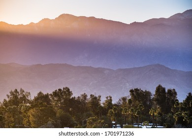 Sunset Landscape in Coachella Valley, with sun rays shining on the rocky ridges of the San Jacinto mountains, Palm Desert, California