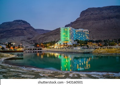 Sunset landscape of the coast and spa hotels in Dead Sea, Israel. The Dead Sea surface and shores are 430.5 m below sea level - Earth's lowest elevation on land.