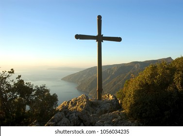 Sunset landscape with Cross on side of Holy Mount Athos, Greece