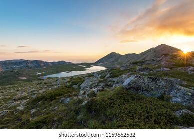 Sunset landscape with Kamenitsa peak and Tevno lake, Pirin Mountain, Bulgaria.