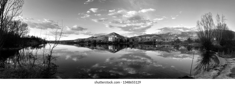 Sunset landscape of lake and mountains of old Europe in black and white