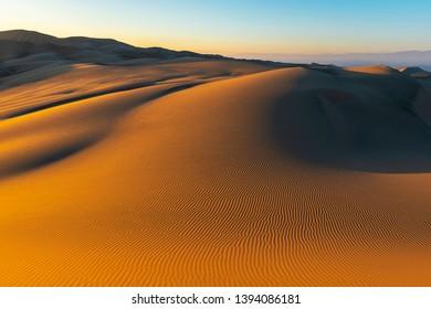 Sunset landscape in the majestic coastal peruvian desert located between Ica and Huacachina, Peru, South America.