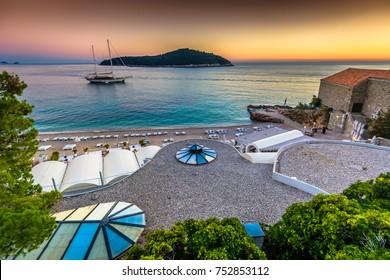 Sunset landscape over summer beach in Dubrovnik Riviera with island Lokrum in background , Croatia Mediterranean. / Selective focus.