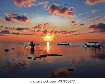 Sunset landscape with sea and cloudy sky. Colorful seascape digital illustration. Asian island sea view with traditional fishing boats on sunset. Peaceful tropical sunset image for banner template