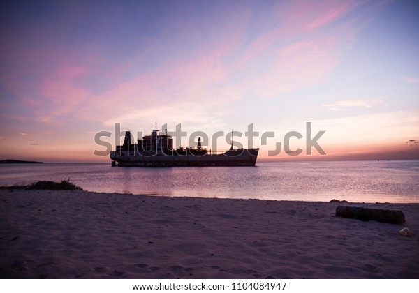 Sunset landscape with ship