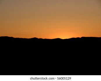 Sunset with landscape silhouette