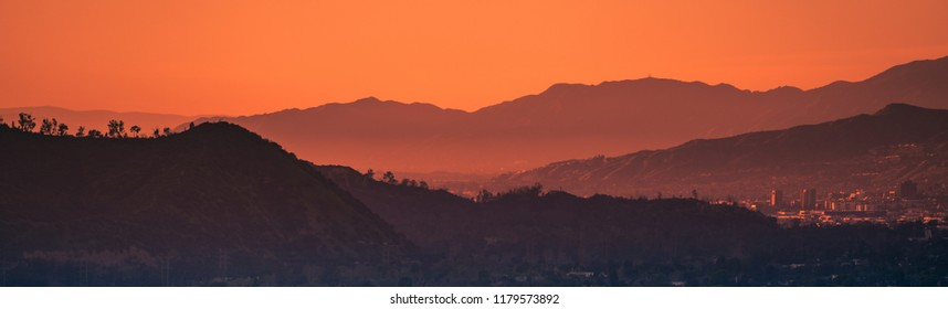Sunset landscape view of silhouette mountains in Los Angeles California