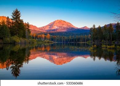 Sunset at Lassen Peak with reflection on Manzanita Lake, Lassen Volcanic National Park, California