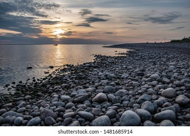 Sunset late at night midlands with stones after the beach. Date June 16 2019