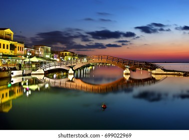 "Sunset at Lefkas (Lefkada) town, at the small marina for the fishing boats with the nice wooden bridge. Eptanisa (means ""Seven Islands""),  Ionian sea, Greece."