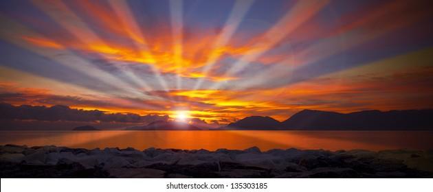 Sunset in Lerici - Liguria Italy / Sunset over the Gulf of La Spezia Liguria Italy, in the background Portovenere, Palmaria Island and Tino