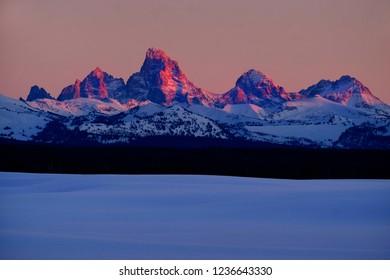 Sunset light with alpen glow on Tetons Tetons mountains rugged