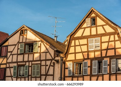The sunset light illuminate the facade of some buildings in the historical district of Colmar, France.