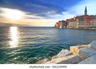 Sunset light illuminates the sea and Venetian buildings in Rovinj, Croatia