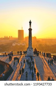 Sunset light on Danube river, Viktor statue and column and people in fortress Kalemegdan in Belgrade Serbia