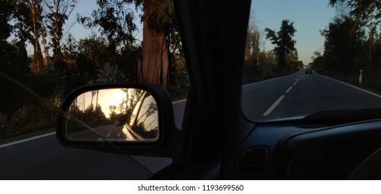 Sunset light on rear view mirror.