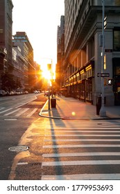 Sunset light shines on an empty crosswalk at the intersection of 23rd Street and 5th Avenue in Manhattan, New York City NYC