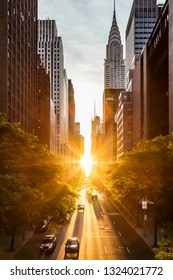 Sunset light shining on the buildings and cars on 42nd Street in Midtown New York City around the time of the Manhattanhenge summer solstice