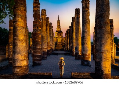 Sunset and light in Sukhothai historical park with Asian traveller walking on the temple, this image can use for travel, Bangkok, Thailand and landmark in aisa concept