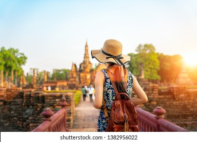 Sunset and light in Sukhothai historical park and wat Sri chum with Asian traveller walking on the temple, this image can use for travel, Bangkok, Thailand and landmark in aisa concept