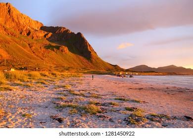 Sunset lit mountains in Norway. Lofoten islands landscape.