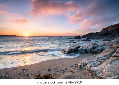 Sunset from Little Fistral beach, a small sheltered cove beneath the Towan headland at Newquay on the Cornish coast