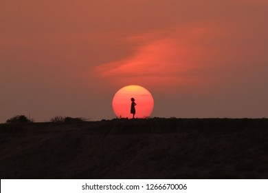 Sunset with little girl