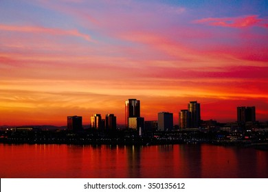 Sunset long beach Los Angeles california, seen on the brightly colored building and sky