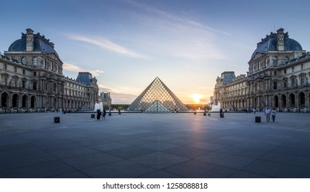 Sunset at Louvre museum with pyramid and fountain. 9th June 2017, Paris, France.