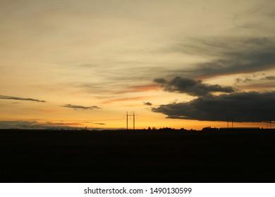 Sunset magic clouds amber light - Shutterstock ID 1490130599