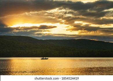 Sunset Maine Lake with Boat and Mountains