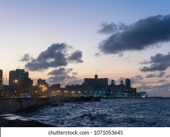 Sunset at Malecon, the famous Havana promenades where Habaneros, lovers and most of all individual fishermen meet, Havana, Cuba