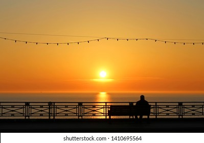 Sunset and man on the bench in Blackpool, England