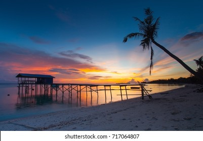 Sunset at Mantanani Island,Sabah,Borneo.The island has long stretch of white sandy beaches and crystal clear water. Sitting on the beach with the sea breeze blowing on your face is just pure heaven.