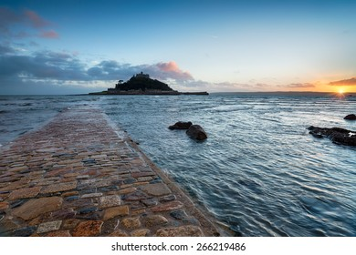 Sunset from Marazion in Cornwall looking out towards St Michael's Mount at high tide