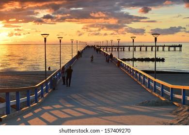 Sunset at the marine pier of Palanga, Lithuania, Europe