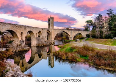 Sunset at the Medieval bridge of the Besalu (Catalonia, Spain)