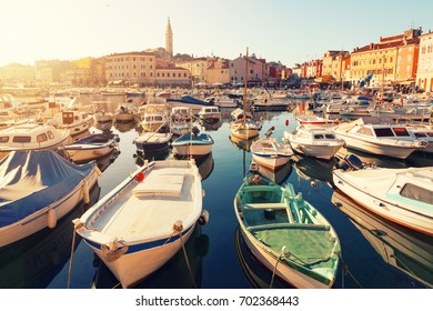 Sunset at medieval town of Rovinj, colorful with houses and church,harbor in Croatia