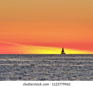 sunset in the Mediterranean with sailboat