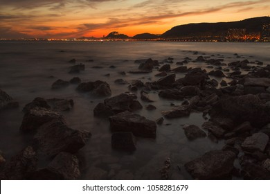 Sunset at the mediterranean sea with Alicante City for great vacation